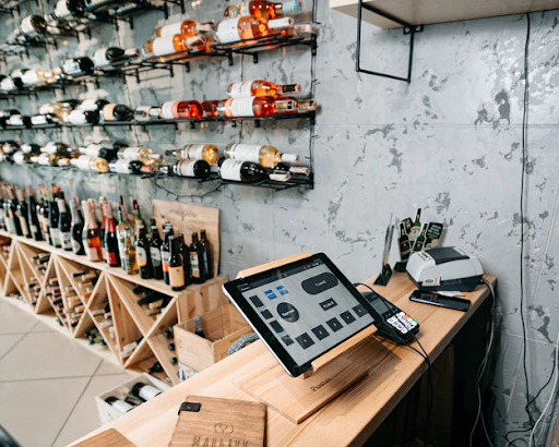 A tablet POS system on a stand in a wine shop and bar